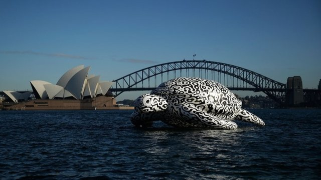 "To celebrate the World""s First Undersea Art Exhibition, a 5 metre tall, 15 metre long Sea Turtle cruises past Sydney Harbour"