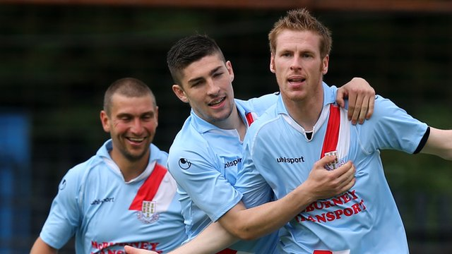 Ballymena players celebrate victory over Portadown