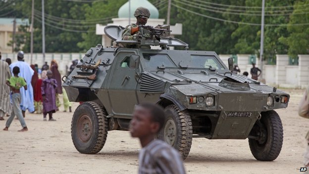 Nigerian soldier patrols in armoured car in Maiduguri, Nigeria, on 8 August 2014