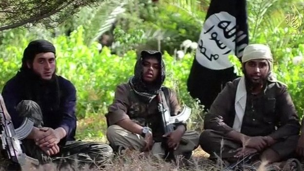 Still from unverified Isis video footage purporting to show Reyaad Khan (c) Nasser Muthana (r) from Wales