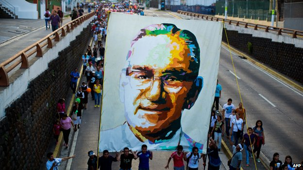 Catholics march in San Salvador on 22 March 2014 during the commemoration of the 33th anniversary of the murder of Oscar Romero