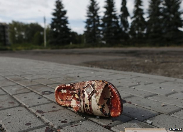 A bloodstained sandal lies on a street in Makiika, near Donetsk, 19 August