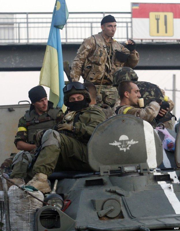Ukrainian paratroopers pass through Druzhkivka, Donetsk region, 19 August