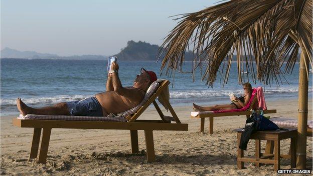 Tourists relaxing on a Burmese beach