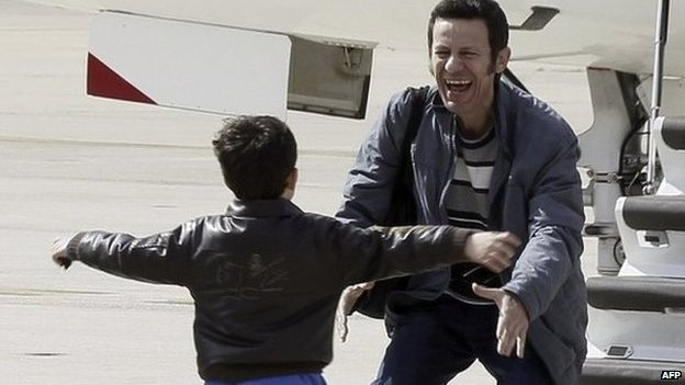 Spanish journalist Javier Espinosa is reunited with his son after six-month capture in Syria