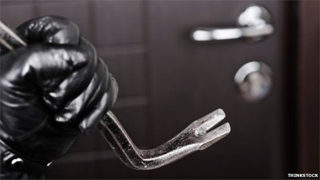 Gloved hand with crowbar