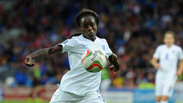 Forward Eniola Aluko scores England's second as they extend their lead against Wales in Cardiff.