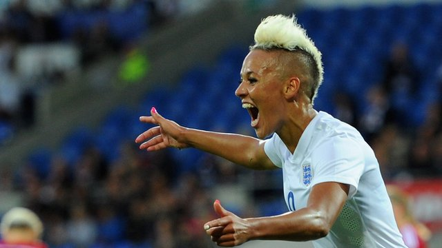 Lianne Sanderson scores on the stroke of half-time with a bullet header to make it 0-4 to England.