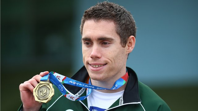 Jason Smyth shows off his T12 200m gold on Thursday