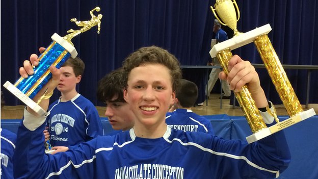Christopher Herndon, a diabetic teenage boy, with basketball trophies in hand