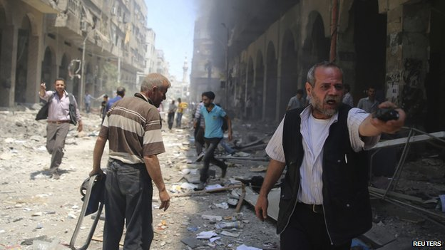 A man reacts in a damaged street due to what activists claimed was a car bomb explosion in a market in central Duma in the eastern al-Ghouta, near Damascus June 15, 2014