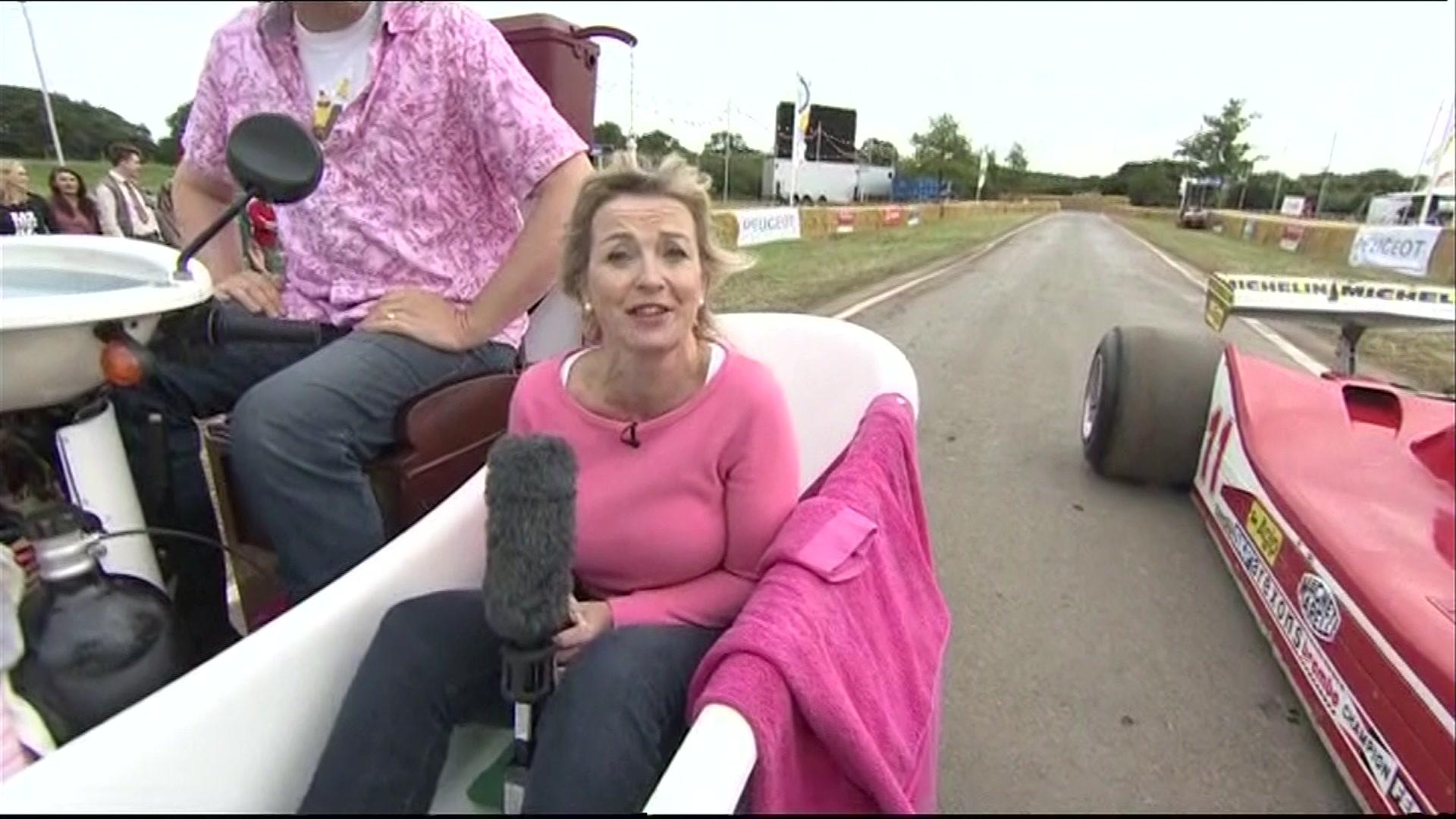 Carol Kirkwood in a motorised bathroom at a classic car festival