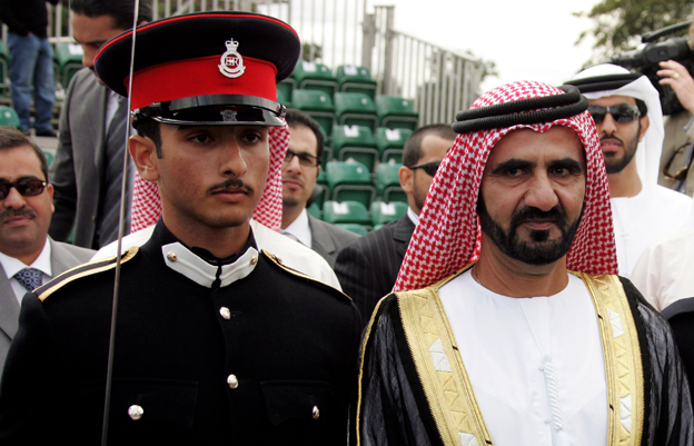 The Emir of Dubai Mohammad bin Rashid Al Maktoum with his son after his Passing Out Parade at Sandhurst in 2006