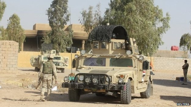 Iraqi security forces in an area of Diyala province retaken from IS, 12 August 2014.