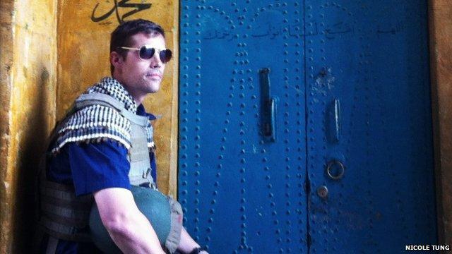 James Foley sitting in a doorway in Syria