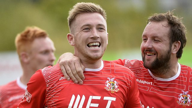 Portadown's mark McAllister celebrates scoring against Crusaders