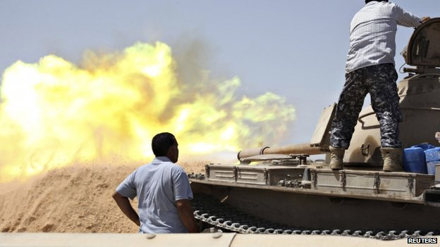A tank belonging to the Western Shield, a branch of the Libya Shield forces, fires during a clash with rival militias west of Tripoli