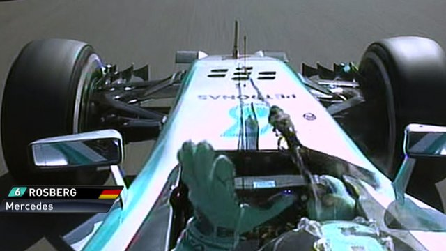 Mercedes' Nico Rosberg removes debris