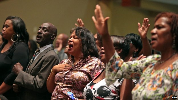 Mourners sing inside the Friendly Temple Missionary Baptist Church, St Louis,
