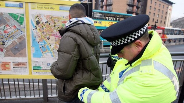 Police officer carrying our a stop-and-search