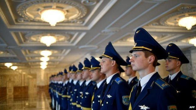 A Belarusian honour guard awaits the start of the summit in Minsk, 26 Aug