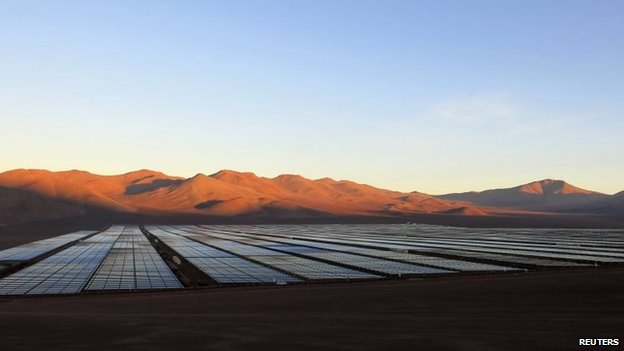 Solar panels of local mining company CAP are seen in the Atacama Desert on 5 June, 2014.