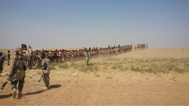 Photo posted online purportedly showing Syrian army soldiers in their underwear being led through the desert by Islamic State fighters - 27 August 2014