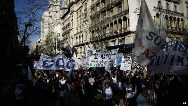 People march towards the Congress during a protest in Buenos Aires on 27 August 2014