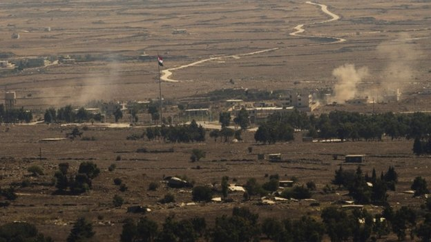 Smoke rises from the Syrian Golan Heights during clashes between Syrian rebels and government forces on 28 August 2014