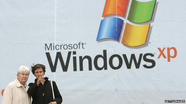 Women in front of Windows XP poster