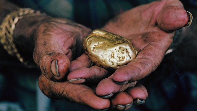 Hands holding gold