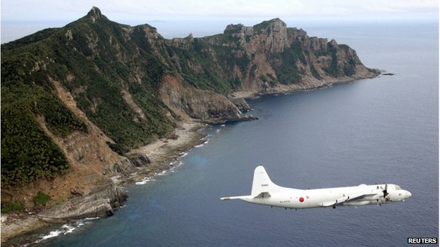 Japan Maritime Self-Defence Force's PC3 surveillance plane flies around the disputed islands in the East China Sea, known as the Senkaku isles in Japan and Diaoyu in China, in this 13 October 2011 file photo