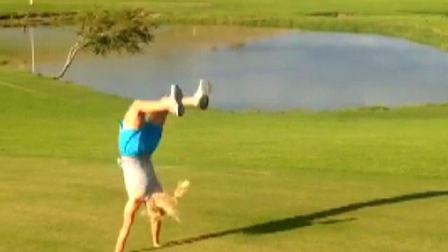 Golfer Carly Booth's demonstrates her unusual warm-up
