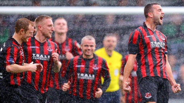 Crusaders captain Colin Coates celebrates scoring a free-kick against Glentoran at Seaview
