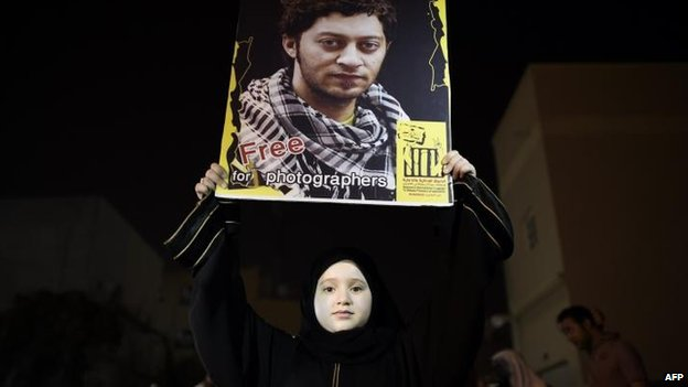 A Bahraini girl holds up a portrait of Ahmed Humaidan during a protest in Sitra, 30 August