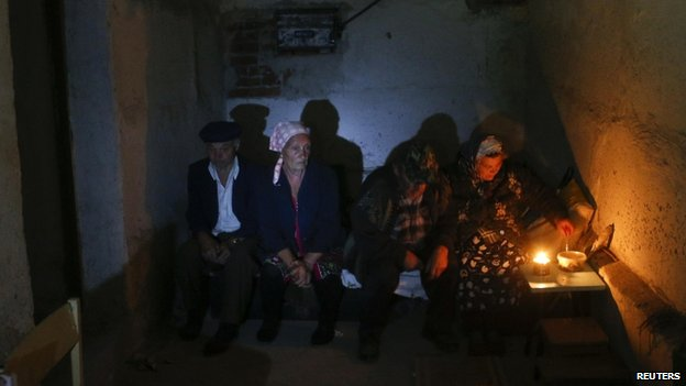 Local residents hide in a basement on the outskirts of Donetsk - 1 September