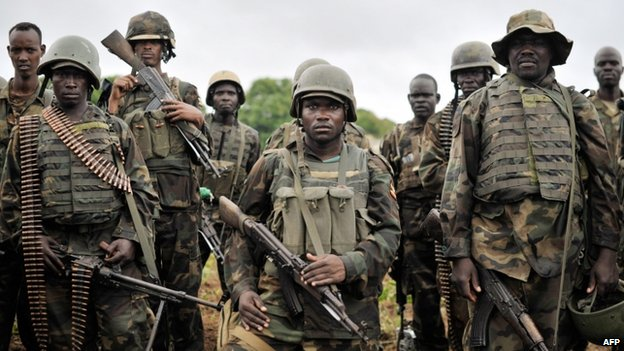 Ugandan soldiers, part of the African Union Mission in Somalia (AMISOM), preparing to advance on the town of Kurtunwaarey in the Lower Shabelle region of Somalia (1 September 2014)