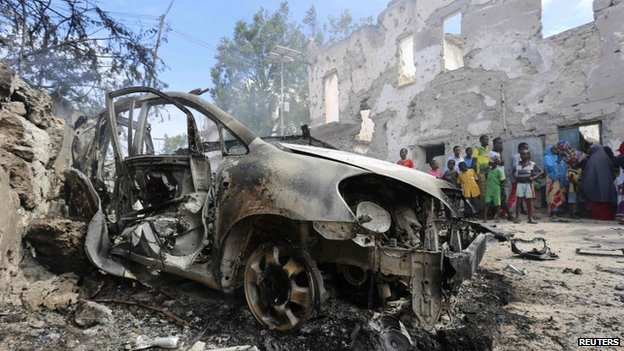 A destroyed car after an attack by suspected militants at the Jilacow underground cell inside a national security compound in Mogadishu (31 August 2014)