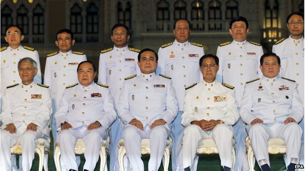 Thai military junta chief and newly appointed Prime Minister General Prayuth Chan-ocha (centre, seated) and unidentified cabinet members pose for a group photo after a swearing-in ceremony at the Government House in Bangkok, Thailand, 4 September 2014.