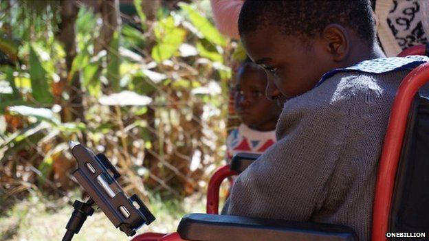 Disabled child in Malawi using app