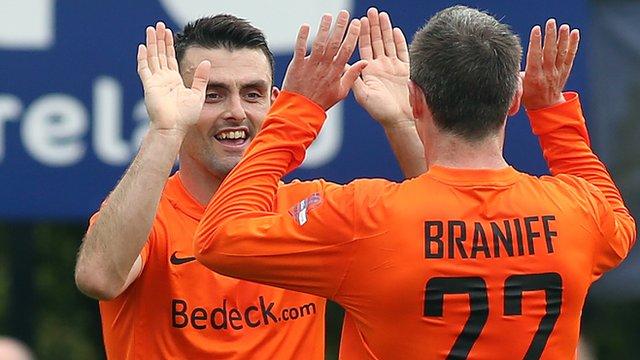 Glenavon's Eoin Bradley celebrates with Kevin Braniff