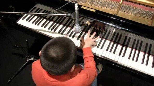 Jose Andre Montanho playing piano