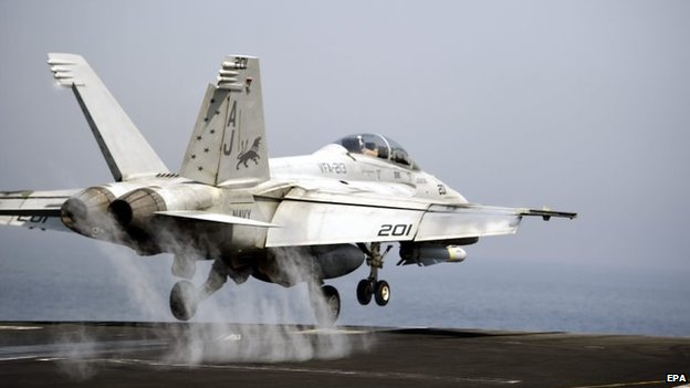 A US Navy F/A-18 Hornet takes off from the USS George HW Bush in the Gulf (15 August 2014)