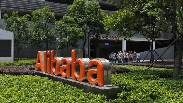 Chinese workers walk out from the Alibaba head office building in Hangzhou, in eastern China's Zhejiang province on 21 May 2012.