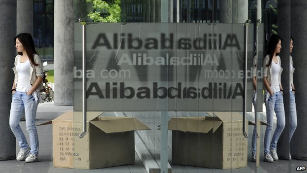 A Chinese woman walks out from the Alibaba head office building in Hangzhou, in eastern China's Zhejiang province on 21 May 2012.