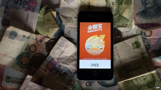 The logo of Yuebao, an investment product of Alibaba's online payments platform Alipay, displayed on a smartphone in Shanghai on 13 July 2014.