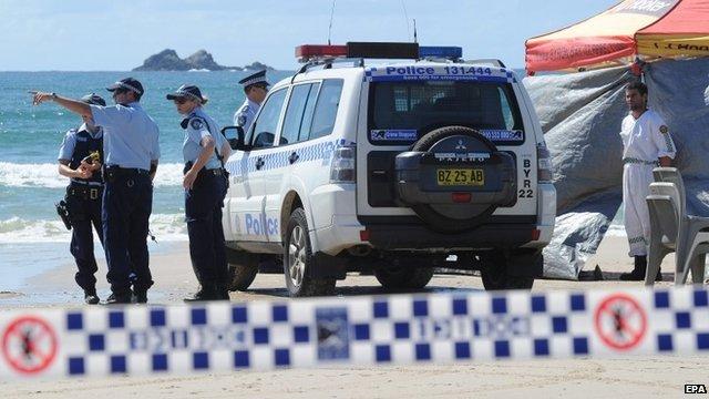 Australian police inspect beach at Byron Bay
