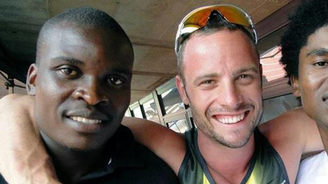 Oscar Pistorius' ex-training partner, Talkmore Nyongani with the six-time Paralympic champion.