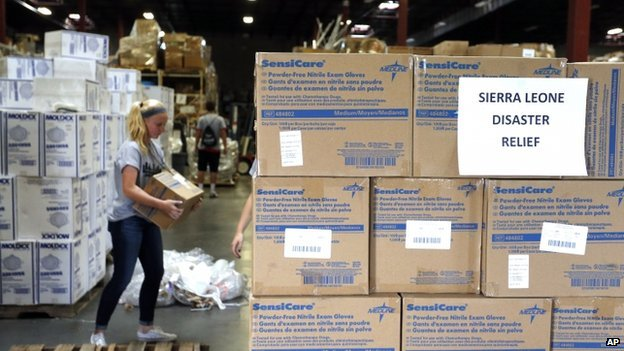 Valor Christian High School sophomore and volunteer Paige Kula loads a pallet with medical supplies bound for Sierra Leone to combat Ebola, inside a warehouse in Centennial, Colorado on 9 September 2014.