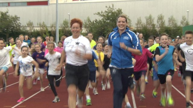Eilidh Child runs with members of Inverclyde Athletics club